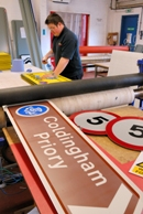 A man making road signs.