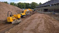 Excavation works diggers at building site